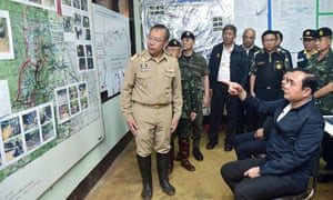 Thai Prime Minister Prayut Chan-o-cha is shown a map of the Tham Luang cave area
