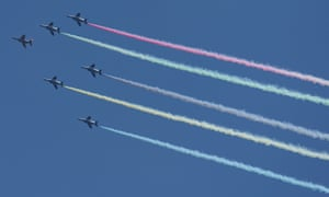Japanese fighter plans leave trails in the Olympic colours.