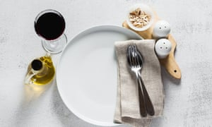 empty plate and a glass of red wine on the table. copy space