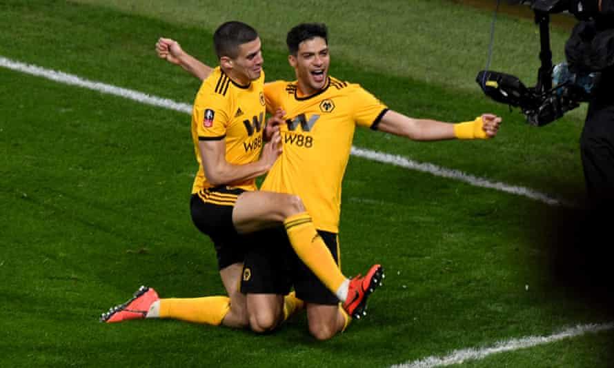 Raul Jiménez (right) celebrates his opener.