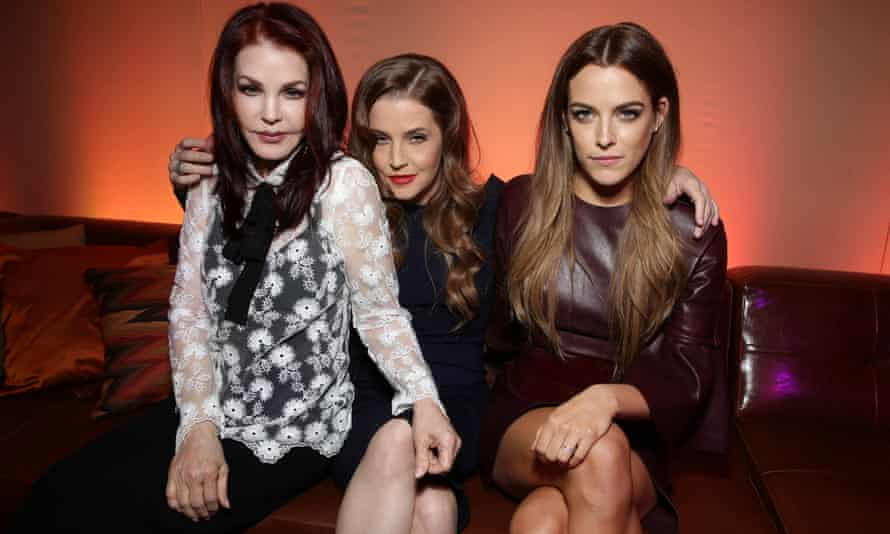 Keough with her mother, Lisa Marie Presley, centre, and grandmother Priscilla, sitting close together, arms around and on each other, on a sofa.