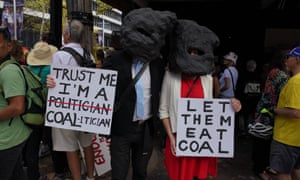 Anti-coal mining protesters join thousands in Sydney on 24 March.