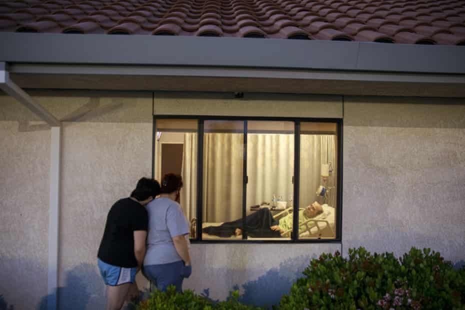 Relatives visit a loved one in a nursing facility in Lindsay, California.