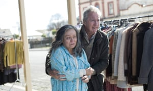Jacki Weaver and Bryan Brown on the street of Clunes near racks of clothes