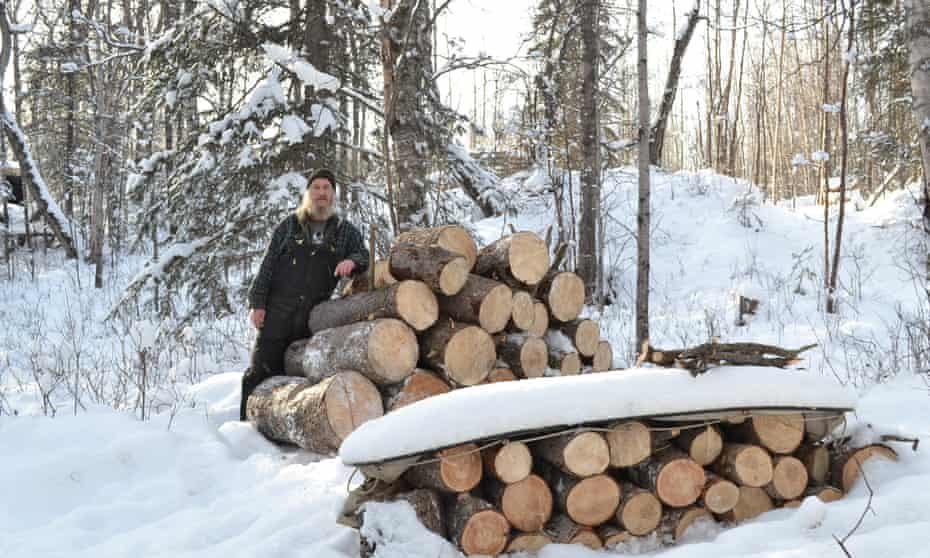 Joe Ford with a pile of wood he chopped