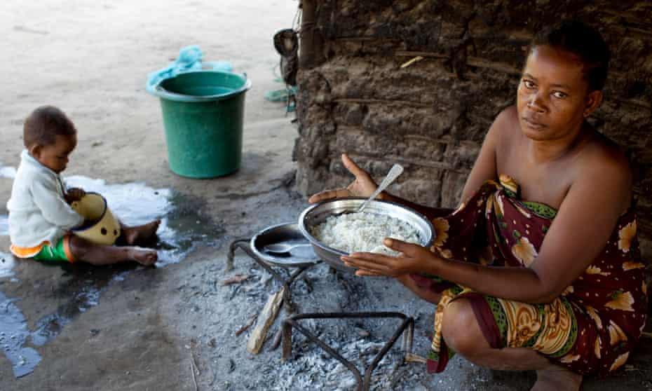 Monja, a mother of six children, prepares a meal of rice at her home in Bekalalao village in Madagascar.