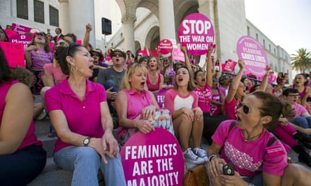 Activists chant as they rally in support of Planned Parenthood in Los Angeles. CPCs are sometimes located close to Planned Parenthood locations.