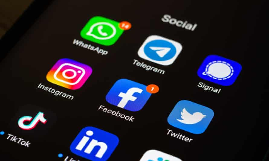 App icons, including WhatsApp and Facebook, on a smartphone