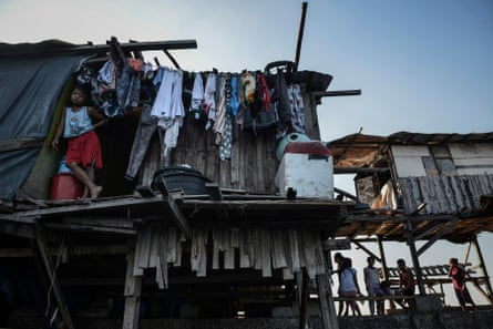 Makeshift houses along a breakwater in polluted Manila Bay, Philippines