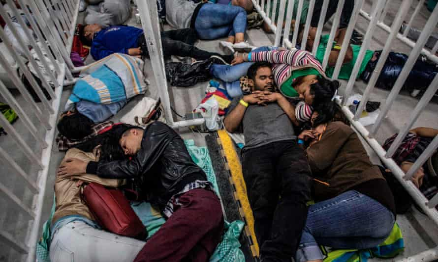 Venezuelan migrants living in Medellin, Colombia sleep as they wait to attend a job fair on 27 September. The United Nations reported that 2.6 million Venezuelans are now living abroad.