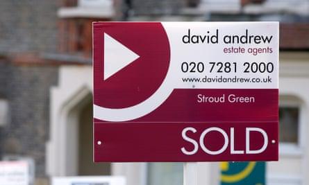 A sold estate agent sign