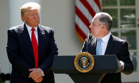 Donald Trump listens to EPA Administrator Scott Pruitt after announcing his decision that the United States will withdraw from the Paris Climate Agreement, in the Rose Garden of the White House in Washington, U.S., June 1, 2017.