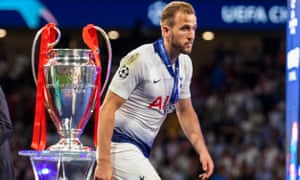 Harry Kane walks past the European Cup after defeat by Liverpool last year, the closest he has come to silverware with Tottenham.