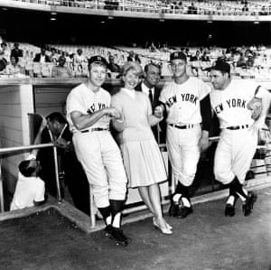Actors Doris Day and Cary Grant pose with New York Yankees players, Mickey Mantle, Roger Maris and Yogi Berra