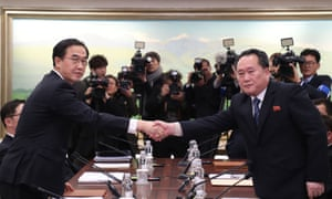 South Korea's unification minister Cho Myung-gyun, left, shakes hands with North Korean chief delegate Ri Son-gwon at the border truce village of Panmunjom in the Demilitarized Zone on Tuesday.