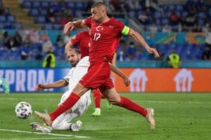 Turkey's Burak Yilmaz is tackled by Italy's Giorgio Chiellini.