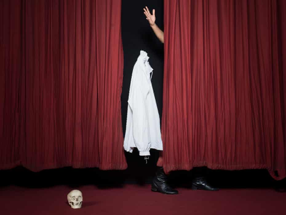 White shirt between red theatre curtains, thrown by Rhik Samadder's hand, with skull on floor in front
