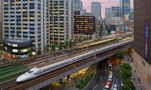 A bullet train travels through central Tokyo.
