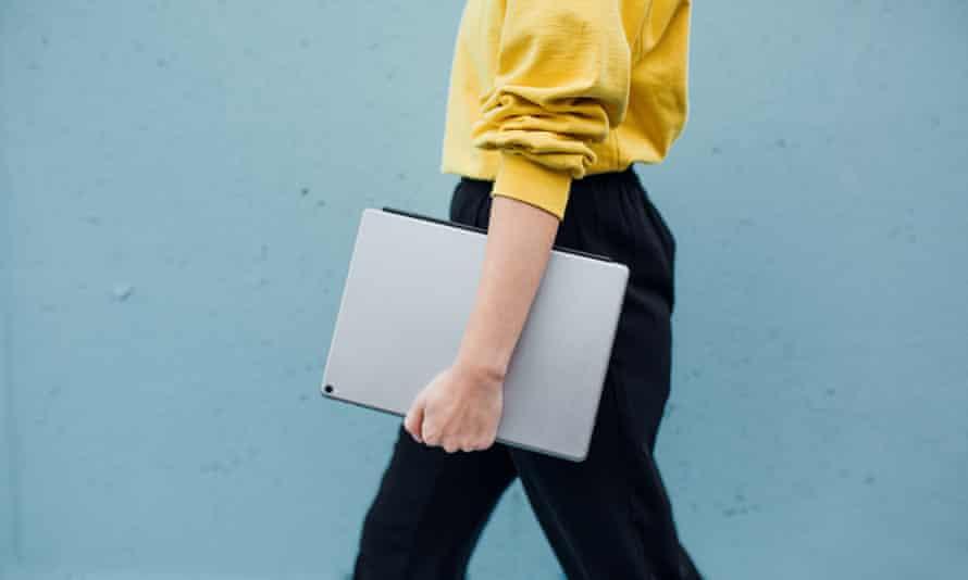 Stylish woman Walking Against Blue Background