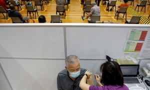 A man receives his vaccination at a coronavirus disease vaccination centre in Singapore.