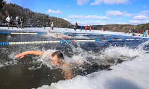 Vilnius, Lithuania: people swim at an annual winter competition in freezing water, with temperatures dropping to -2C (28.4F)