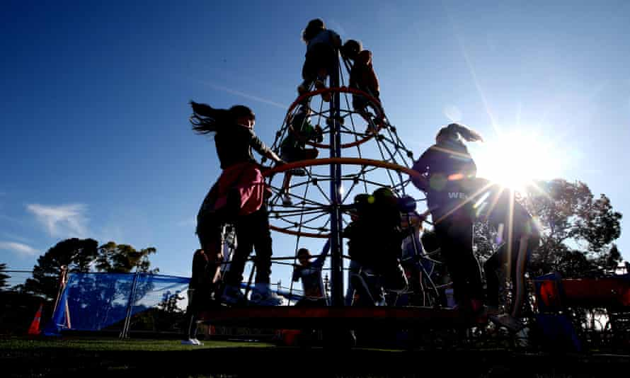 Students play on their return to Laingholm Primary School in Auckland
