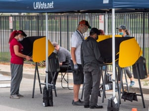 People vote at an early voting station for the special congressional election in Lancaster, California on 10 May 2020.