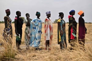 Women queue as they wait to receive food rations at a village in Ayod county, South Sudan