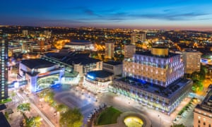 Birmingham city centre at night, showing Centenary Square and the Library of Birmingham.