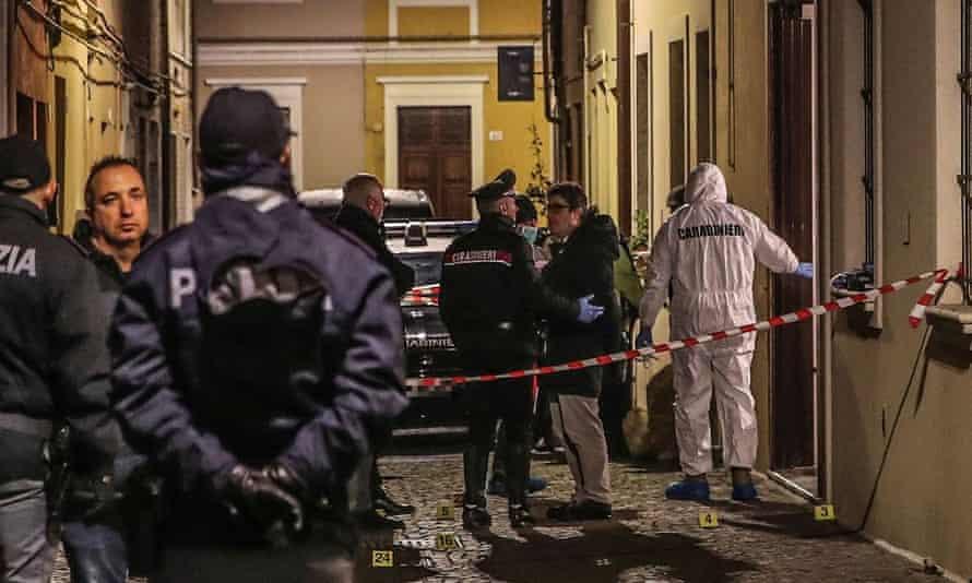 Italian police near the scene where Marcello Bruzzese, brother of a mafioso, was killed in Pesaro