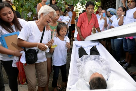 The funeral of five-year-old Francis Mañosca, who died with his father, Domingo, during an attack by unidentified gunmen.