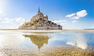 Mont St Michel: 'The delicate, light-filled cloisters seem suspended between sea and sky.'