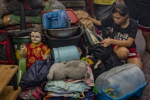 Manila, Philippines A statue of Jesus is seen next to other retrieved belongings after a fire engulfed houses in a slum