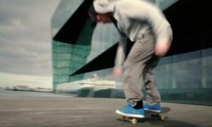 Man skateboards outside Harpa, a building in Reykjavik - not Rhode Island.