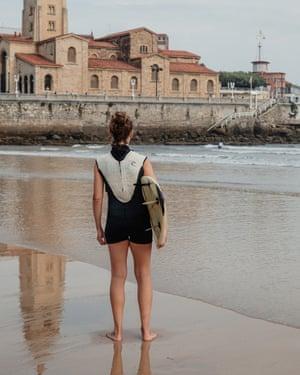 Surfing in Gijón.
