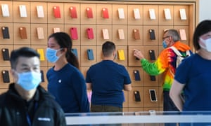 Apple staff work at the flagship store in Sydney, Australia.
