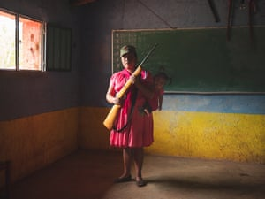 A female member of the community defence force holds her weapon. Since early 2019, the village has been attacked repeatedly by Los Ardillos cartel, prompting residents to take action. Rincón de Chautla, Guerrero, 10 June 2019