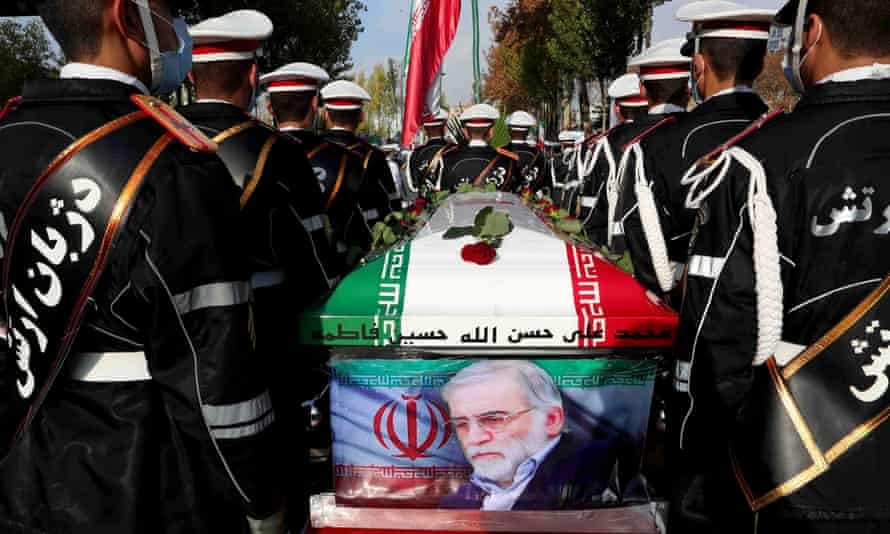 Members of Iranian forces carrying the coffin of Iranian nuclear scientist Mohsen Fakhrizadeh during a funeral ceremony in Tehran on Monday