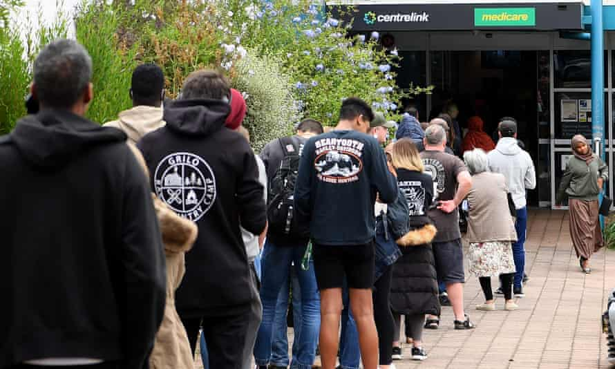 People are seen lining up at Centrelink in Flemington on March 23, 2020 in Melbourne, Australia.