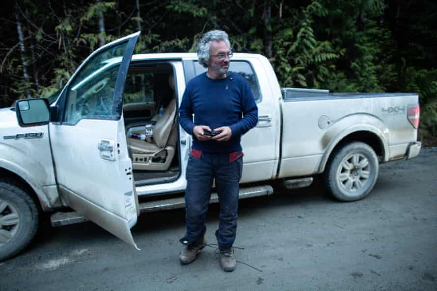 Trevor Simpson makes a satellite phone call after being refused access to a cut block by members of the Rainforest Flying Squad.