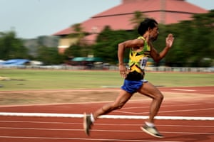 A man from the 55-60 age category competing in the 400m sprint