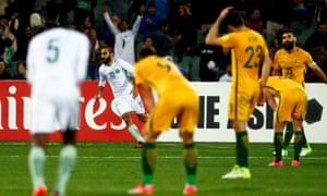 Mohammed Al Sahlawi (C) celebrates scoring .