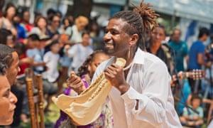 Afro-Peruvian musician Jos Ballumbrosios playing a quijada instrument, or donkey jaw.