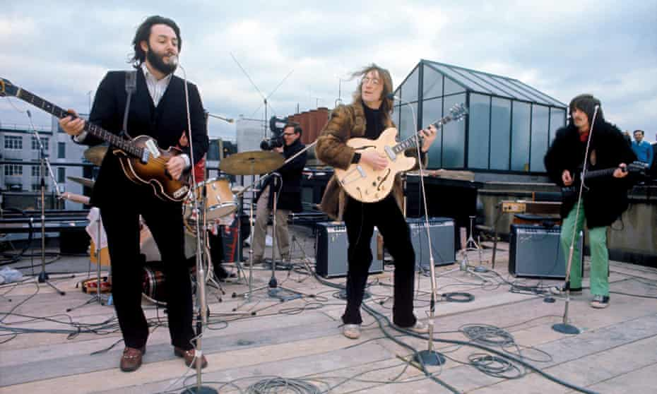 The Beatles perform on the roof of the Apple Corps building, 3 Savile Row, London W1, 30 January 1969 – the final public performance of their career.