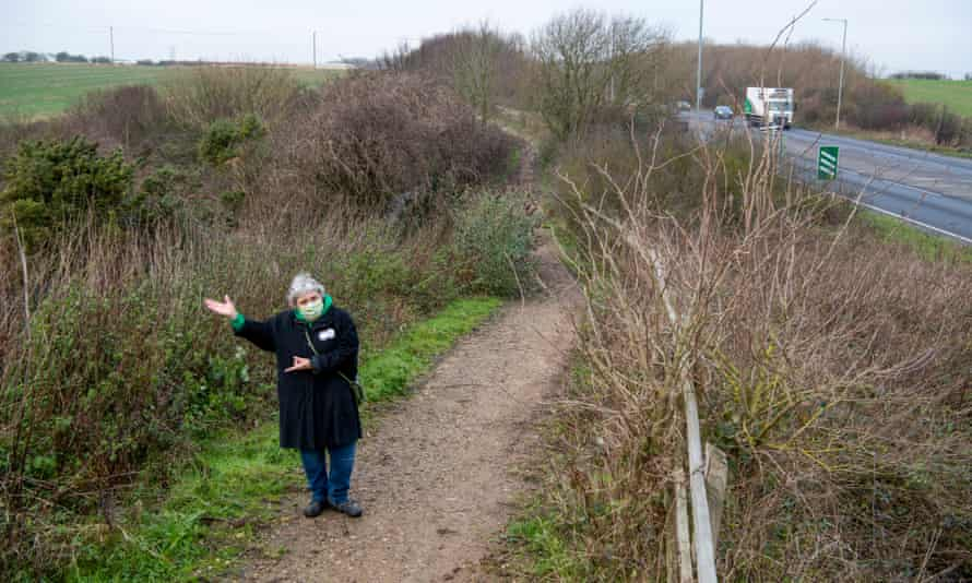 Sarah Gleave pointing to the planned lorry park.