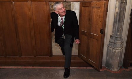 The Speaker of the House of Commons, Lindsay Hoyle, climbs through the secret doorway into the passageway.
