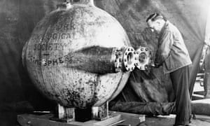 Dr William Beebe with a bathysphere.