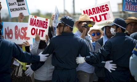 People stage a rally in Okinawa over American military presence in Japan.