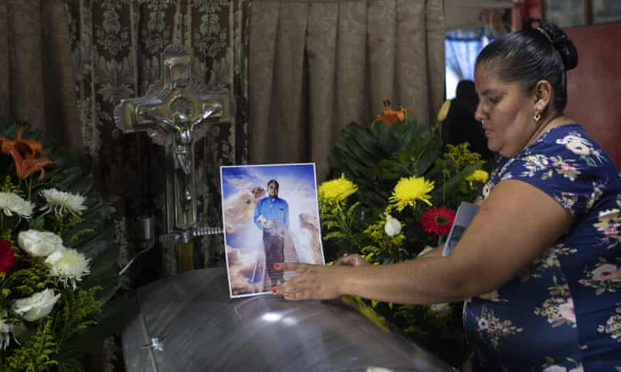 A woman places a photo of slain journalist Julio Valdivia on his casket at his home in Tezonapa, Mexico, in September. More journalists were killed in Mexico than anywhere else in 2020.