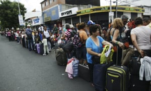 People queue while they wait to cross the border to Colombia at San Antonio in Tachira state, Venezuela, on Sunday.